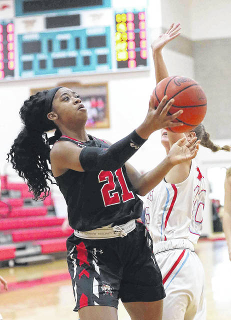 Shawnee's Aaliyah Fowler puts up a shot against Lima Central Catholic's Sophia Santaguida during Saturday's game at LCC.