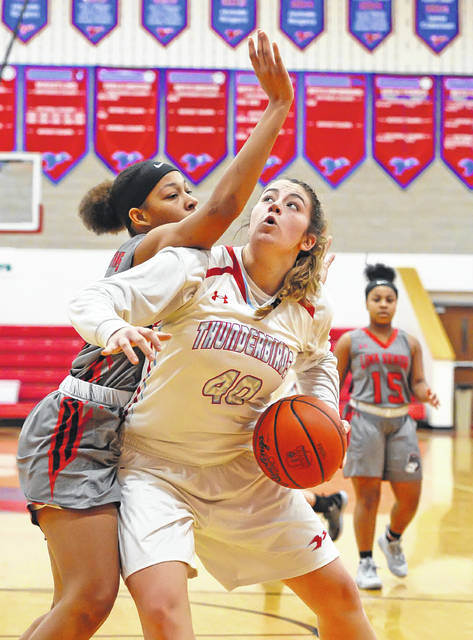 Lima Central Catholic's Rosie Williams goes up for a shot against Lima Senior's Ajohlon Bullock during Saturday's game at Msgr. Edward C. Herr Gymnasium.  Richard Parrish | The Lima News