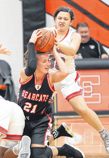 Spencerville's Olivia Goecke fights for the ball against Lima Senior's Taylor Talbert during Friday's Vicki Mauk Holiday Classic at the Elidafield House.