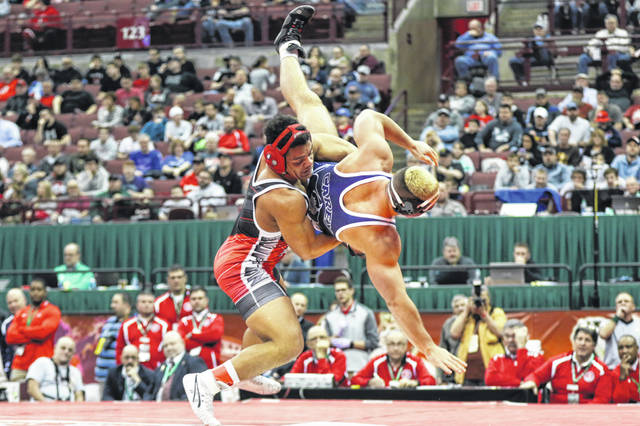 Deandre Nassar of Bluffton, shown here in his Division III 182-pound division championship match against Tanner May of Carey, was an undefeated state champion.
