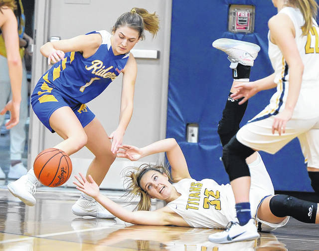 Ottawa-Glandorf's Peyton Warnecke goes to the floor for a loose ball against St. Marys' Carly Caywood during Thursday night's game in Ottawa.