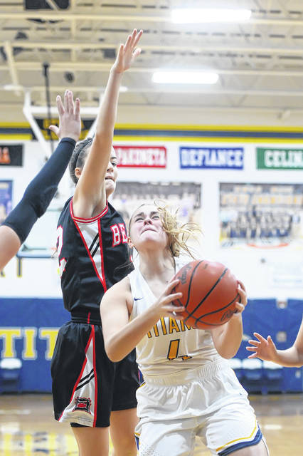 Ottawa-Glandorf's Kelsey Erford puts up a shot against Spencerville's Emma Leis during Saturday's game in Ottawa.