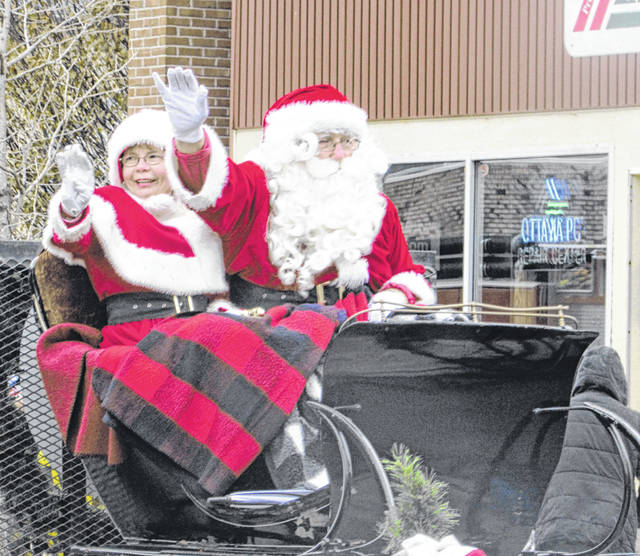 Santa and Mrs. Claus greet parade goers in the 27th Annual Welcome Santa Parade in downtown Ottawa on Sunday.