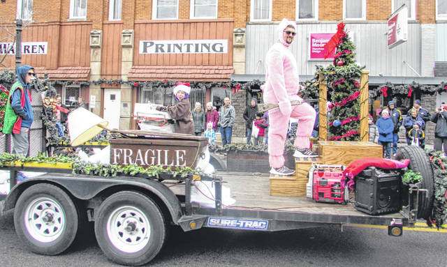"""Croy's Towing, Ottawa, decorated their float to celebrate characters from the Christmas movie """"A Christmas Story."""""""