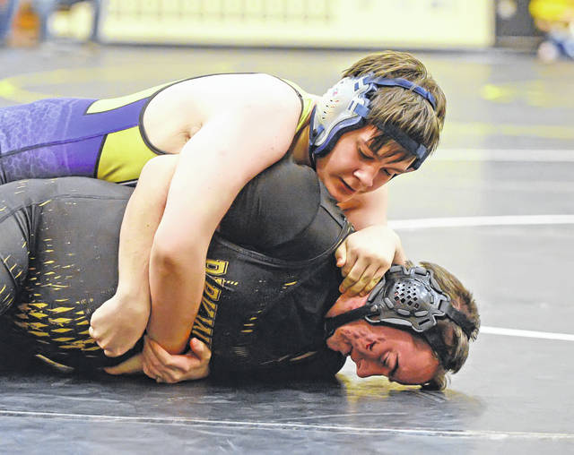 Ada's Jonathan McClain, top, wrestles Parkway's Billy Popp during Saturday's Parkway Holiday Invitational.