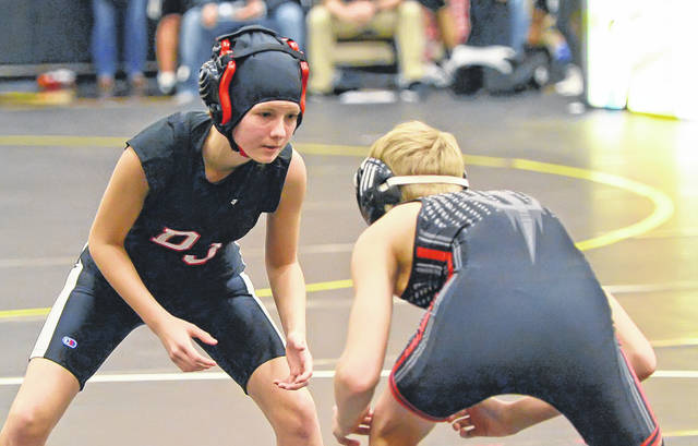 Delphos Jefferson's Emma Dailey, left, wrestles Tippecanoe's Oliver Murry during Saturday's Parkway Holiday Invitational.