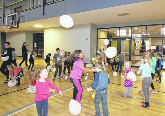 "Children who attended the ""Noon Years Eve Party"" at Leipsic Community Center caught balloons during the balloon drop Tuesday afternoon."