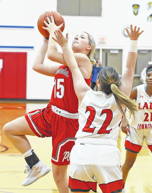 Pandora-Gilboa's Lexie Neuenschwander shoots against Perry's Caitlin Shively during Monday's game at Leonard V. Volbert Gymnasium.