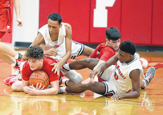 Shawnee's John Barker, left, goes to floor for a loose ball with Perry's Jeffrey Simpson during Tuesday's game at Leonard V. Volbert Gymnasium.
