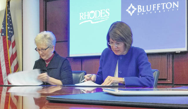 Dr. Cynthia Spiers, left, of Rhodes State College, and Dr. Jane Wood, right, of Bluffton University, sign a Memorandum of Understanding to help meet the demand for nurses in the region.