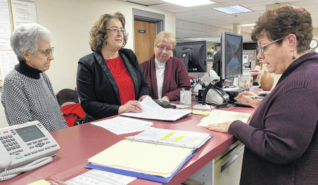 Beth Seibert (center) filed her petition to run for Allen County Commissioner Monday afternoon with Kathy Meyer at the Allen County Board of Elections. She was joined by campaign chair Alberta Lee (left) and treasurer Karen Sneary (right).