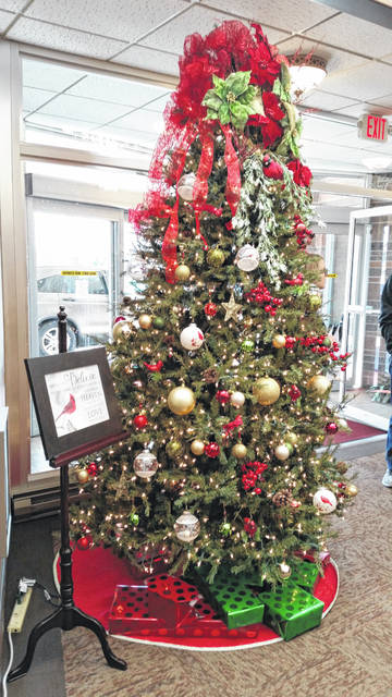 The Tree of Remembrance stands in the lobby of the Shawnee Chapel of Chiles-Laman Funeral and Cremation Services.
