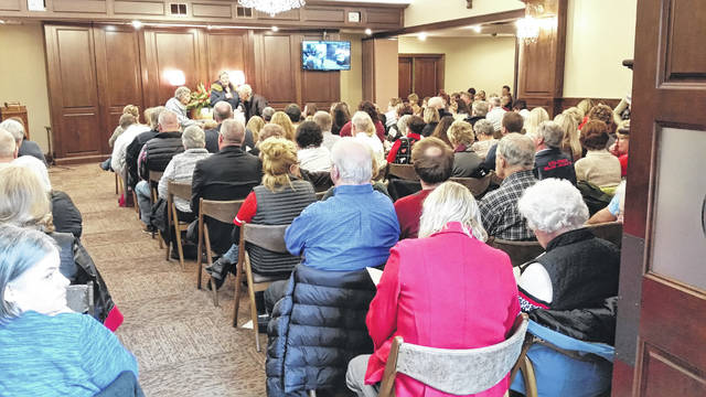 More than 400 people filled Chiles-Laman Funeral Home for the Tree of Remembrance Service.