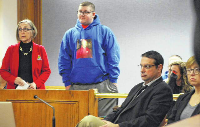 Jordan VanBuskirk, in the blue sweatshirt, wrote a letter that was read in a Lima courtroom Monday about the 2016 shooting death of his father, Ryan VanBuskirk. The letter was read by Crime Victim Services representative Phyllis Neff, left, during the sentencing of Chaz Jackson, who was convicted by a jury last month of involuntary manslaughter in the elder VanBuskirk's death.