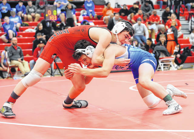 Shawnee's Cory Beach, left, and Allen East's Drake Carmean compete in Saturday's Allen County Tournament at Bluffton High School.
