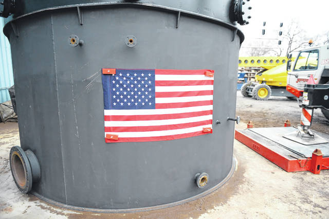 An American flag is displayed on the tank with magnets at International Tank Service Inc. This is the largest vessel ever built by International Tank Service.