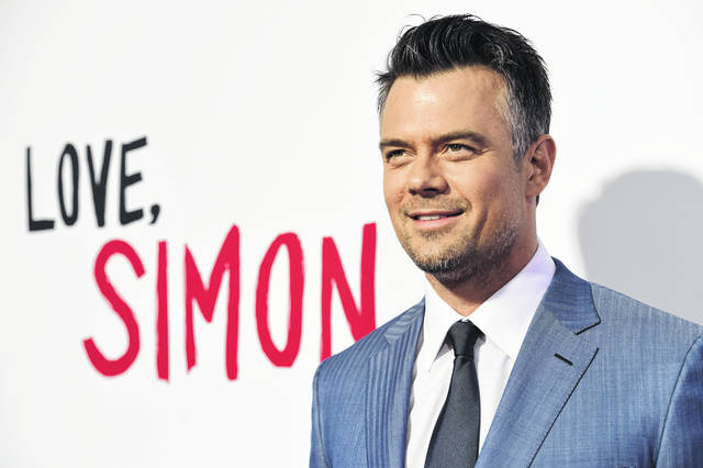 "FILE - In this March 13, 2018 file photo, Josh Duhamel arrives at a special screening of ""Love, Simon"" in Los Angeles. Duhamel will continue promote his home state of North Dakota. North Dakota's tourism department confirmed Tuesday, Dec. 31, 2019 to The Associated Press that the star of several ""Transformers"" movies will be paid $175,000 to be the face of the state's tourism campaign for the next two years."