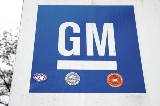 FILE - This Oct. 16, 2019, file photo shows a sign at a General Motors facility in Langhorne, Pa. General Motors and Korea's LG Chem have formed a joint venture to build an electric vehicle battery cell factory near Lordstown, Ohio, east of Cleveland.
