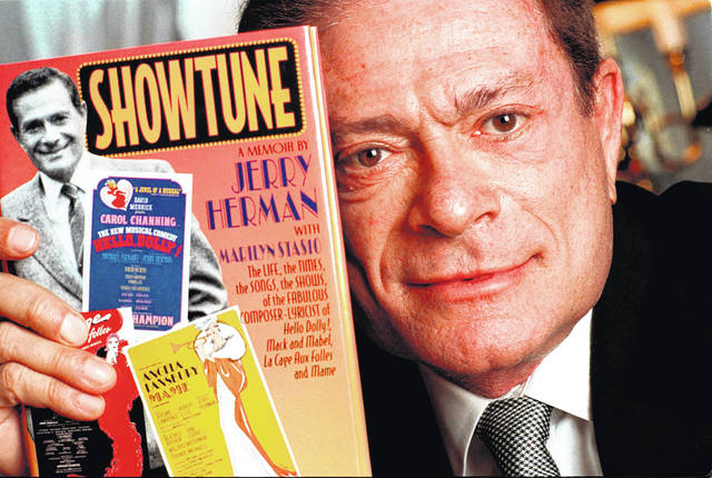 """FILE - In this Nov. 19, 1996, file photo, composer Jerry Herman displays his book """"Showtune,"""" in New York. Herman, the Tony Award-winning composer behind """"Hello, Dolly!"""" and """"La Cage aux Folles,"""" has died at age 88."""