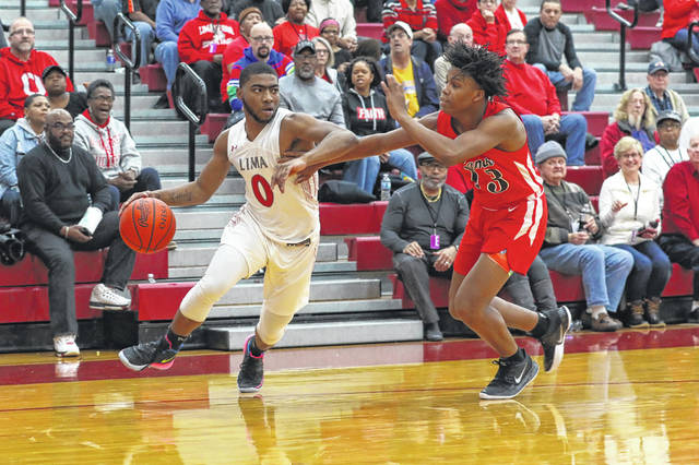 Lima Senior's Da'San Clair looks to get past Toledo Roger's Shawn-Carr Middlebrooks during Saturday night's Kewpee Holiday Classic championship game at Lima Senior.