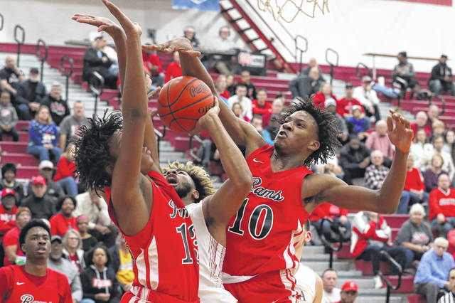 Lima Senior's Jamir Simpson tries to put up a shot against Toledo Roger's Shawn-Carr Middlebrooks, left, and Da'Sean Nelson (10) during Saturday night's Kewpee Holiday Classic championship game at Lima Senior.