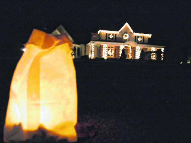 A luminary can be seen outside a home in Shawnee Township during the 2018 edition of Shawnee Luminary Night.