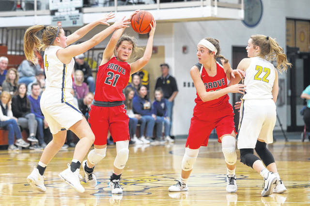 Columbus Grove's Kenzie King keeps control over the ball against Ottawa-Glandorf's Kelsey Erford (4) Columbus Grove's Erin Downing (10) and Ottawa-Glandorf's Brianna Schimmoeller (22) look on during the game at Ottawa-Glandorf High School Thursday.