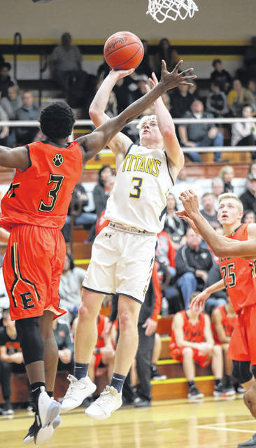Ottawa-Glandorf's Brennen Blevins puts up a shot against Elida's Ja'Quan Moore during Friday night's game in Ottawa.