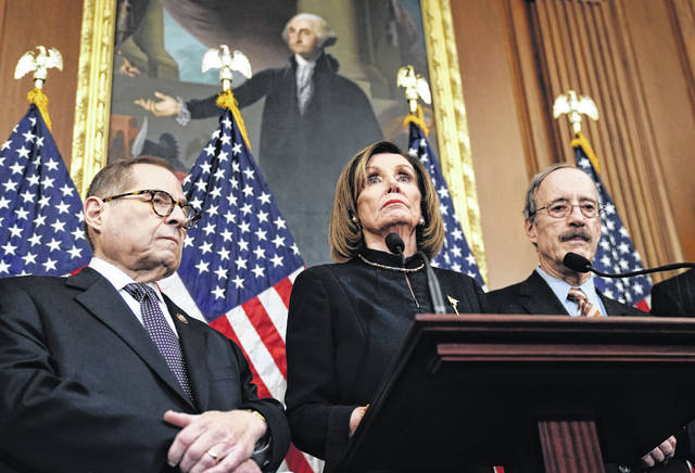 Speaker of the House Nancy Pelosi, D-Calif., flanked by House Judiciary Committee Chairman Jerrold Nadler, D-N.Y., left, and House Foreign Affairs Committee Chairman Eliot Engel, D-N.Y., addresses reporters at the Capitol in Washington, Wednesday, Dec. 18, 2019, after the House of Representatives voted to impeach President Donald Trump on two charges, abuse of power and obstruction of Congress.