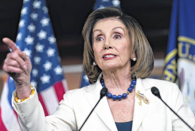 "In a somber address at the Capitol, Speaker of the House Nancy Pelosi said Thursday that President Trump ""is trying to corrupt, once again, the election for his own benefit. The president has engaged in abuse of power, undermining our national security and jeopardizing the integrity of our elections."" (AP Photo/J. Scott Applewhite)"