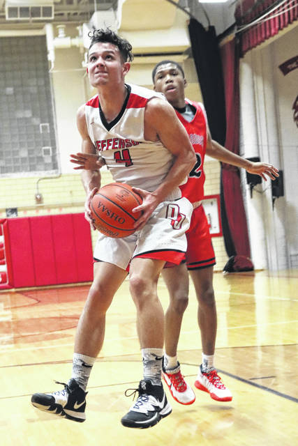 Delphos Jefferson's Ian Wannemacher (4) eyes the basket during Saturday night's game against Perry in Delphos.