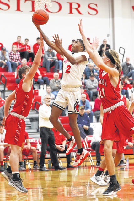 Perry's Will Knight takes a shot against Wapakoneta during the game at the Perry High School on Saturday afternoon.