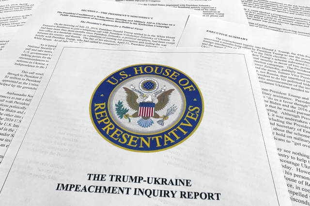 The report from Democrats on the House Intelligence Committee on the impeachment inquiry into President Donald Trump is photographed in Washington, Tuesday, Dec. 3, 2019. The House released a sweeping impeachment report outlining evidence of what it calls Trump's wrongdoing toward Ukraine. The findings will serve as the foundation for debate over whether the 45th president should be removed from office.