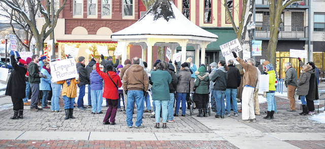 Wendy Chappell-Dick speaks during a rally for the impeachment of President Trump at the gazebo in the Lima Town Square on Tuesday evening.