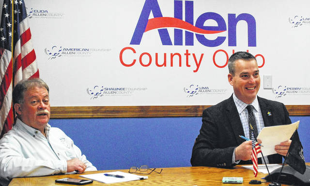 Allen County Commissioners Greg Sneary, left, and Cory Noonan put the wraps on 2019 with a five-minute special meeting on Friday. Noonan will serve as board president in 2020.