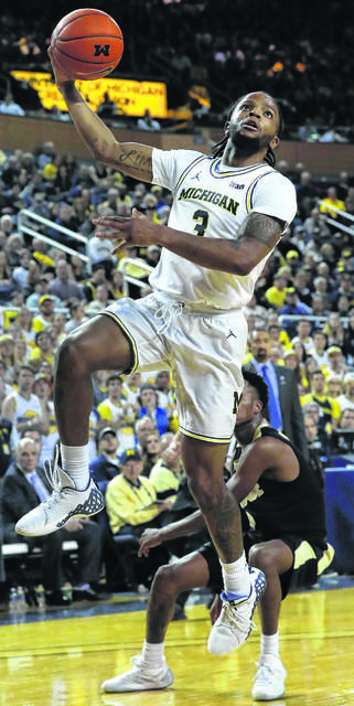 Michigan's Xavier Simpson drives past Purdue's Eric Hunter Jr. during a game earlier this season in Crisler Arena in Ann Arbor, Mich.