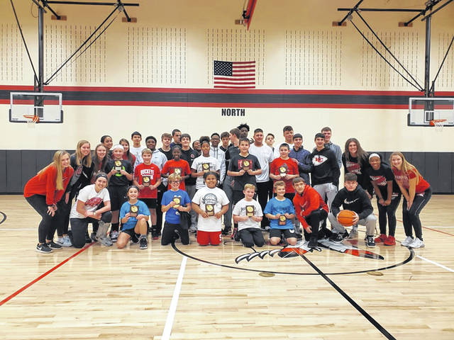 The Shawnee Optimists held their annual Pass, Dribble, Shoot Contest for area students 8-13 years old. Jan. 19. The winners of the event were as follows: Boys 8-9, First: Leo Garlock; Second: Preston McClendon, Boys 10-11, First: Brody Altenbach, Second: Connor Heitmeyer, Boys 12-13: First, Baylor Altenbach, Second: Mason Latham, Girls 8-9: First, Daniyah Denson, Second, Reece Neth; Girls 10-11: First, Bella Hile, Second, Mara Davis; Girls 12-13: First: Zyasija Scott, Second, Addison Neth. Pass, Dribble, Shoot winners with the Shawnee basketball teams who volunteered to help with the event.