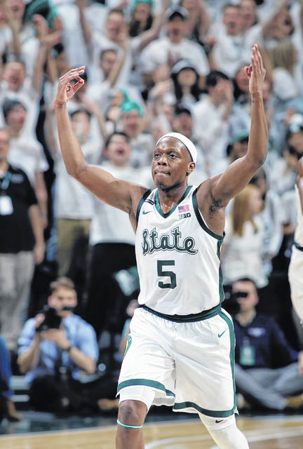 Michigan State's Cassius Winston reacts after sinking a three-point basket against Michigan during the second half of an NCAA college basketball game, Sunday, Jan. 5, 2020, in East Lansing, Mich. (AP Photo/Al Goldis)