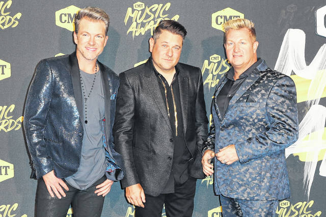 From left, Joe Don Rooney, Jay DeMarcus, and Gary LeVox, of Rascal Flatts, arrive in June 2018 at the CMT Music Awards. The country group Rascal Flatts announced this year will be its farewell tour on its 20th anniversary together.