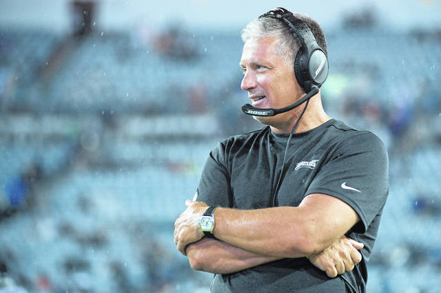 FILE - In this Aug. 15, 2019, file photo, Philadelphia Eagles defensive coordinator Jim Schwartz watches from the sideline during the second half of an NFL preseason football game against the Jacksonville Jaguars, in Jacksonville, Fla. Eagles defensive coordinator Jim Schwartz, who had a five-season run as Detroit's coach, is interviewing Wednesday, Jan. 8, 2020, with the Cleveland Browns. Schwartz is the sixth candidate to meet with the Browns, who are once again looking for a coach after another disappointing, losing season.(AP Photo/Phelan M. Ebenhack, File)