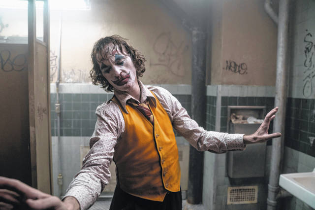 "This image released by Warner Bros. Pictures shows Joaquin Phoenix in a scene from ""Joker."" On Monday, the film was nominated for an Oscar for best picture."