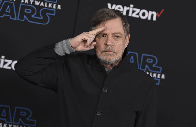 "File - In this Dec. 16, 2019, file photo, Mark Hamill arrives at the world premiere of ""Star Wars: The Rise of Skywalker"" in Los Angeles. The force was strong enough at an Arizona store to reunite Luke Skywalker with his long-lost vinyl record. Hamill is praising workers at Bookmans Entertainment Exchange in Flagstaff for returning the ""Star Wars: A New Hope"" soundtrack that had been a gift from film composer John Williams. Hamill said in a tweet Saturday, Jan. 11, 2020, that it felt ""totally unexpected & positively surreal"" to get back the record he had not seen since the early 1990s. He commended the store about 145 miles (233 kilometers) north of Phoenix for being honest and not selling it. (Jordan Strauss/Invision/AP, File)"