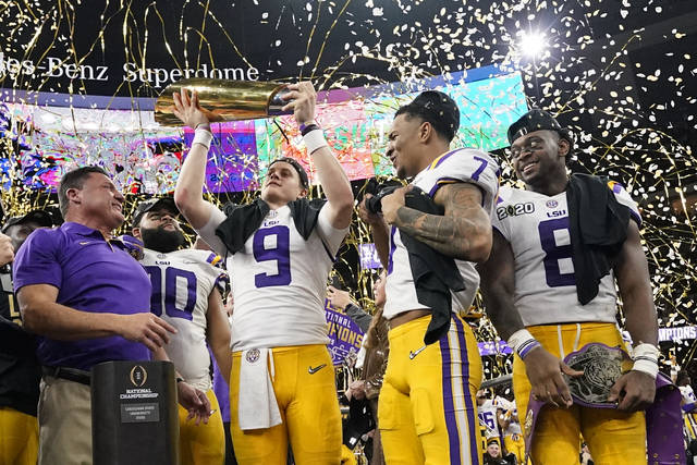 LSU quarterback Joe Burrow holds the trophy after their win against Clemson in a NCAA College Football Playoff national championship game Monday, Jan. 13, 2020, in New Orleans. LSU won 42-25. (AP Photo/David J. Phillip)