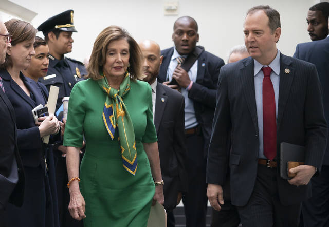 Speaker of the House Nancy Pelosi, D-Calif., joined by House Intelligence Committee Chairman Adam Schiff, D-Calif., leaves a lengthy closed-door meeting with the Democratic Caucus at the Capitol in Washington, Tuesday, Jan. 14, 2020. Speaker Pelosi is expected to appoint House impeachment managers and transmit the two articles of impeachment — abuse of power and obstruction of Congress — by the end of the week. (AP Photo/J. Scott Applewhite)