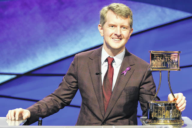 """Ken Jennings holds a trophy on """"JEOPARDY! The Greatest of All Time."""" Jennings, the veteran who beat young hotshot James Holzhauer and Brad Rutter, won the $1 million prize in the tournament that stretched out over four entertaining nights on ABC's prime-time schedule."""