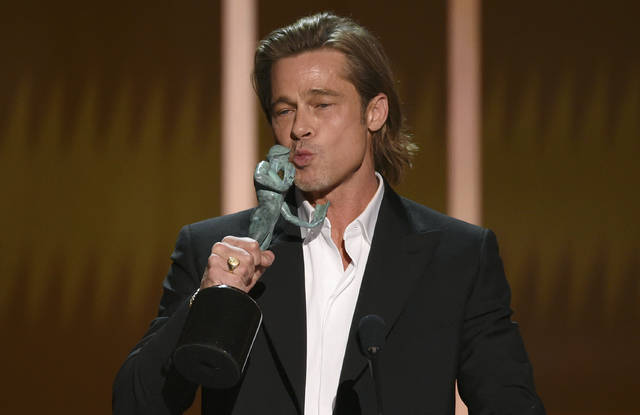 """Brad Pitt kisses """"The Actor"""" statuette as he accepts the award for outstanding performance by a male actor in a supporting role for """"Once Upon a Time in Hollywood"""" at the 26th annual Screen Actors Guild Awards at the Shrine Auditorium & Expo Hall on Sunday, Jan. 19, 2020, in Los Angeles. (Photo/Chris Pizzello)"""
