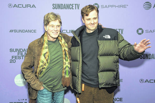 "Robert Redford and his grandson, Dylan Redford, attend the premiere of ""Omniboat: A Fast Boat Fantasia"" during the 2020 Sundance Film Festival on Sunday in Park City, Utah."