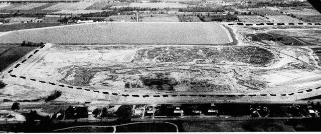 This aerial photo published Oct. 19, 1959, by Lima News photographer Richard Hunter outlined the progress being made at Lima's huge new reservoir, Ferguson Lake. U.S. 30 S is in the foreground, the reservoir embankment is outlined and Metzger Lake is in the background. The reservoir was announced to be finished before Jan. 1, 1960.