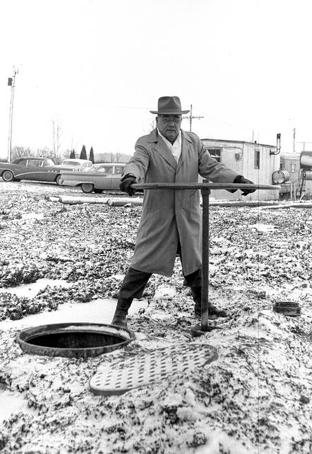 Hobart Bice, water pumping supervisor, opens the giant valve to permit water to flow from almost-full Metzger Lake into the new Ferguson Reservoir in 1960. The water was pumped from the Ottawa River into Metzger, then permitted to drain by gravity flow from Metzger into Ferguson because it was cheaper that way than to pump directly into Ferguson.
