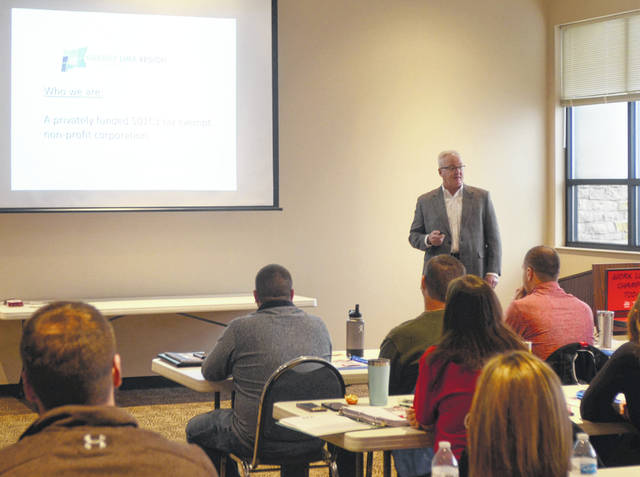 President/CEO of Greater Lima Region Inc. Doug Olsson presents examples of the group's work to the Allen Lima Leadership Class of 2020.